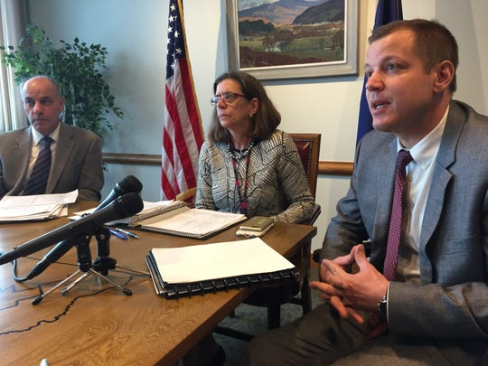 Vermont Finance Commissioner Adam Greshin, from left, Administration Secretary Susanne Young, and Tax Commissioner Kaj Samsom speak to reporters about Gov. Phil Scott's proposed budget Jan. 24, 2019.