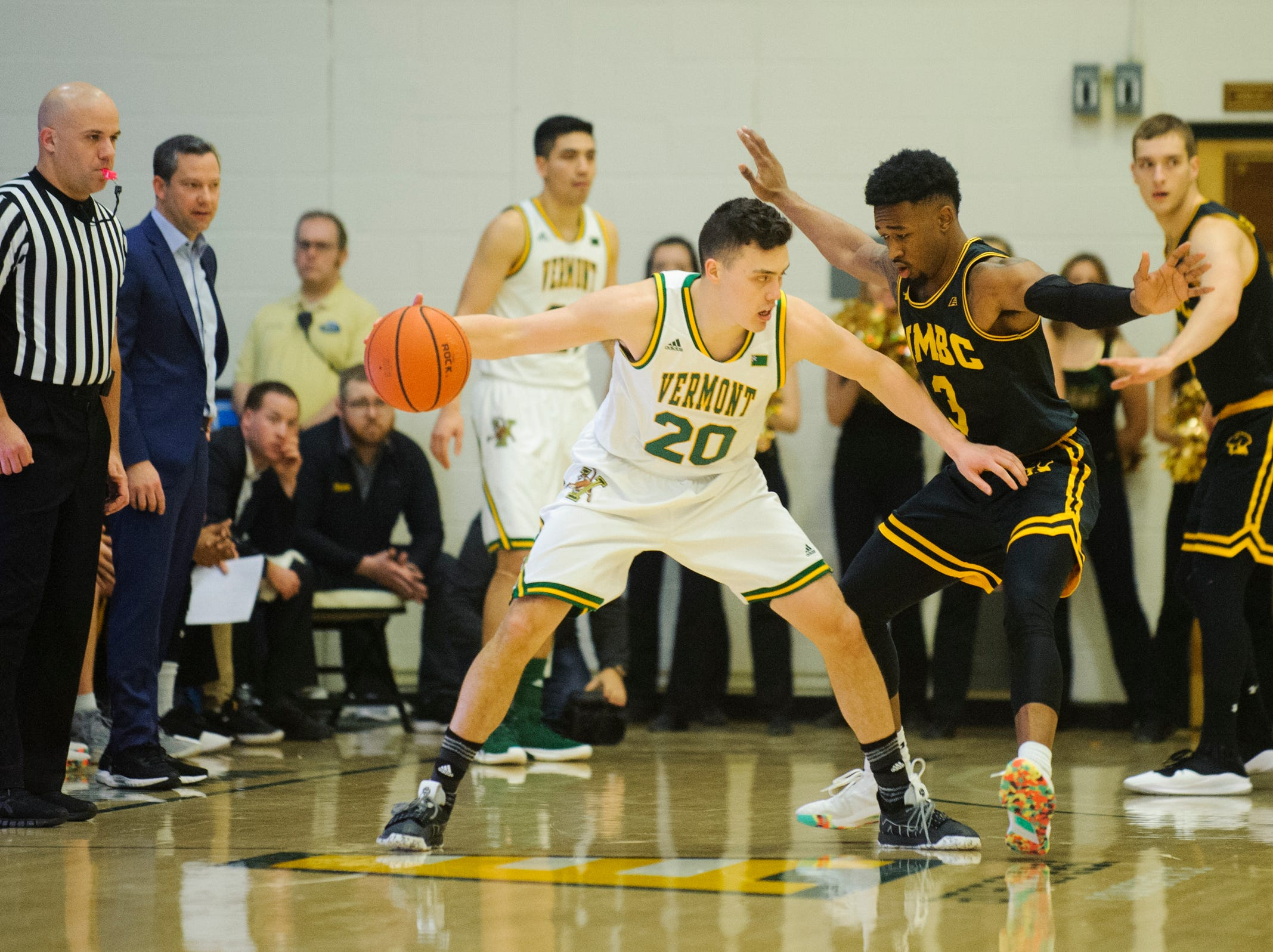 UMBC's K.J. Jackson (3) guards Vermont guard Ernie Duncan (20) during the men's basketball game between the UMBC Retrievers and the Vermont Catamounts at Patrick Gym on Wednesday night January 23, 2019 in Burlington, Vermont.