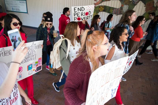 Local students and activists march at Texas A&M University-Corpus Christi to bring awareness to the need for free menstrual hygiene products on campus on Thursday, January 24, 2019. They also delivered signatures to university president Kelly Quintanilla asking for the products. The university is in the process of identifying the most used restrooms on campus to stock them with feminine hygiene products.