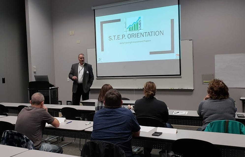 Platinum Horizon President and former mayor Jack Everson leads students through the S.T.E.P orientation.