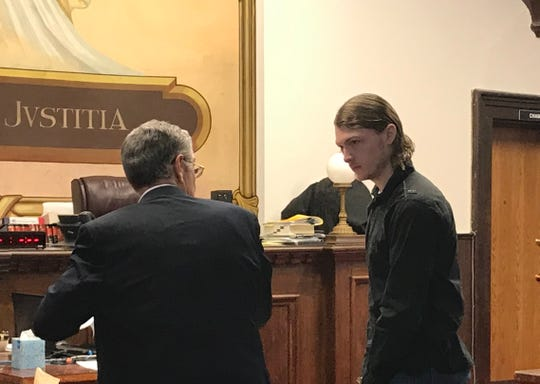 "Edward ""Jake"" Wagner talks with one of his attorneys on Thursday, Jan. 24, 2019, after his second pretrial in Pike County Common Pleas Court on several charges including eight counts of aggravated murder for the 2016 deaths of eight members of the Rhoden family."