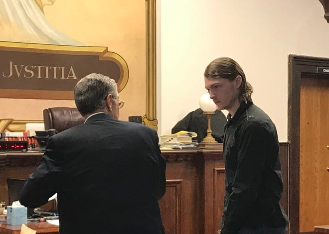 """Edward """"Jake"""" Wagner talks with one of his attorneys on Thursday, Jan. 24, 2019, after his second pretrial in Pike County Common Pleas Court on several charges including eight counts of aggravated murder for the 2016 deaths of eight members of the Rhoden family."""