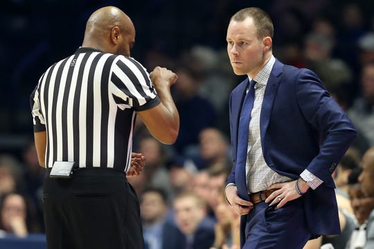 Xavier Musketeers head coach Travis Steele listens to an explain from an official in the first half of an NCAA college basketball game against the Providence Friars, Wednesday, Jan. 23, 2019, at the Cintas Center in Cincinnati.