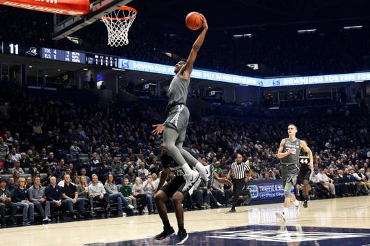 Xavier Musketeers guard Paul Scruggs (1) dunks in the first half of an NCAA college basketball game against the Providence Friars, Wednesday, Jan. 23, 2019, at the Cintas Center in Cincinnati.