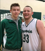 Batavia High School senior Nate Watson, left, joined by Kaleb Moell, learned just before the 2018-2019 season he has cancer and has continued to play while serving as captain.
