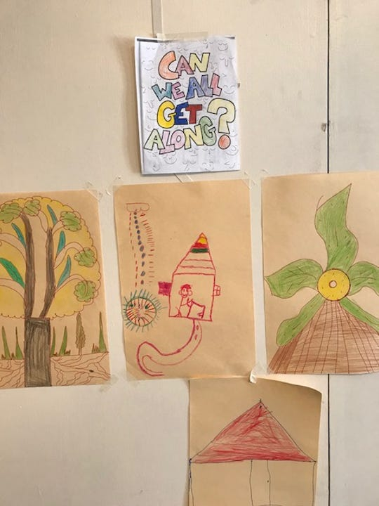 Children's pictures decorate a refugee shelter in El Paso, Texas