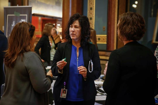Linda Gorkow, left, executive director of the Iowa Food Bank Association, spoke with Iowa lawmakers alongside members of the Iowa Hunger Coalition on Thursday, Jan. 24, 2019, at the Iowa Capitol Building in Des Moines.