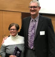 Laura Ingalls Wilder Elementary School third grade teacher and 2018 Indianola Chamber Educator of the Year Sally Van Dorin poses with Indianola Superintendent Art Sathoff.