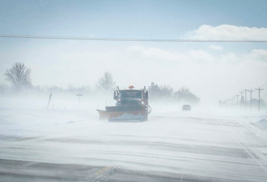 A snow plow clears a path along Highway 69 north of Ankeny on Thursday, Jan. 24, 2019.
