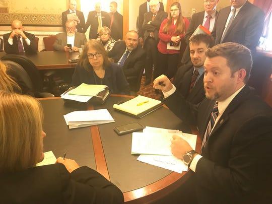 Iowa senators discuss a proposed fireworks bill at the Iowa Capitol on Thursday, Jan. 24, 2019.