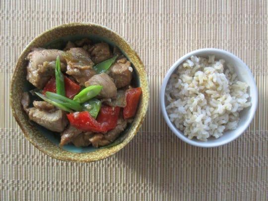 Bourbon Chicken Stir-Fry is served over brown rice.