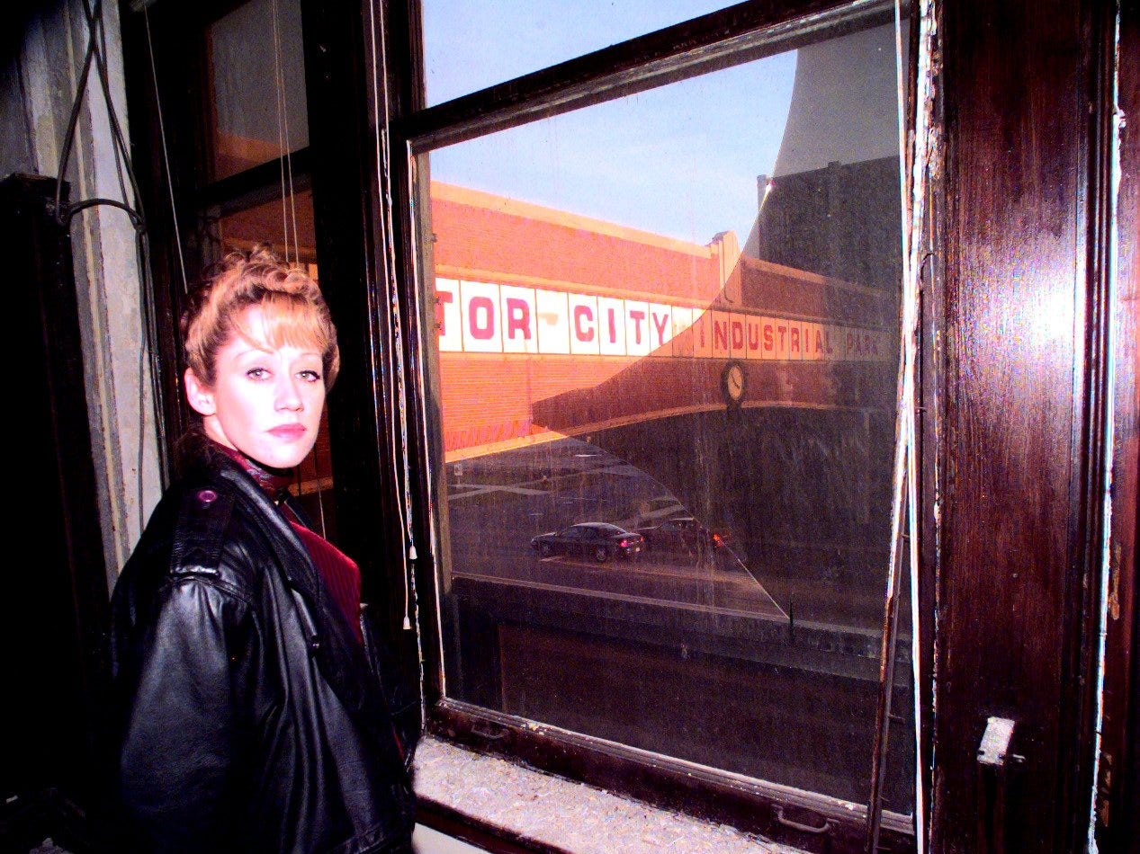 Robin Cristini at a window in the abandoned office section of the Packard Motor Co. that overlooks the elevated crossing of East Grand Blvd. on December, 02, 1998.