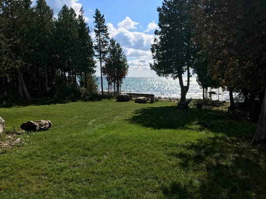 A unique, 299-acre property on Marquette Island in northern Michigan is for sale for $1.6 million.