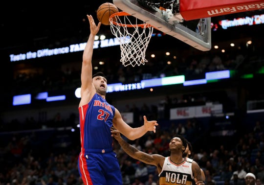 Detroit Pistons center Zaza Pachulia (27) shoots the ball over New Orleans Pelicans guard Elfrid Payton (4) during the second quarter at the Smoothie King Center on Wednesday, Jan. 23, 2019.