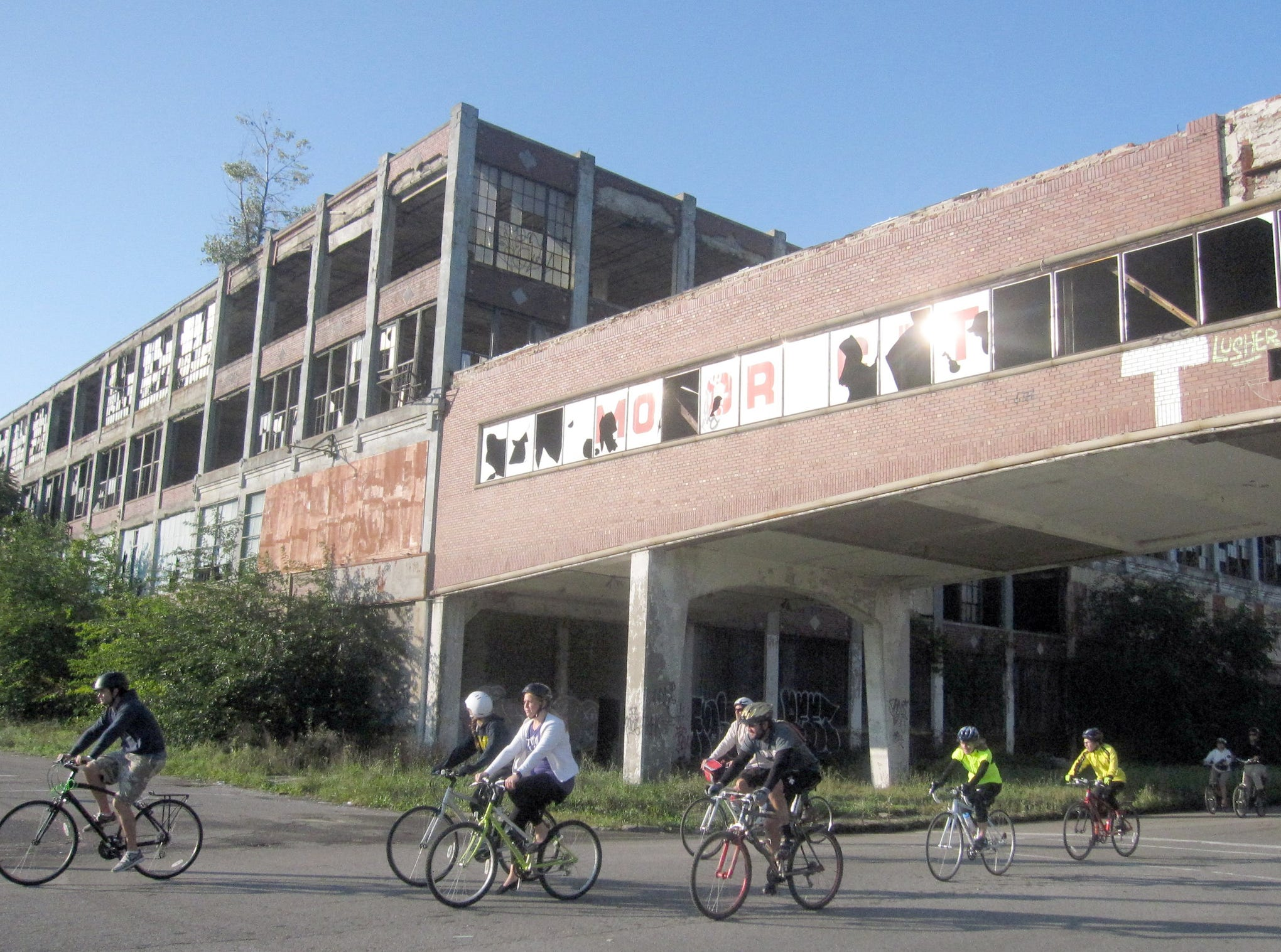 Bicyclists ride past the Packard plant during the 10th annual Tour de Detroit, Saturday, September 24, 2011 in Detroit.