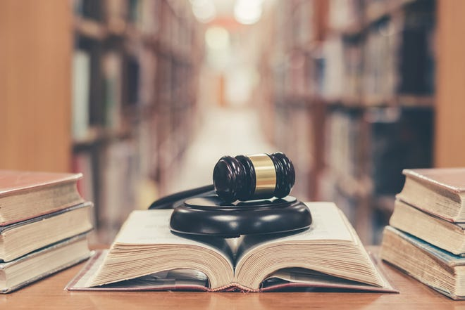 Judge gavel on open law textbook