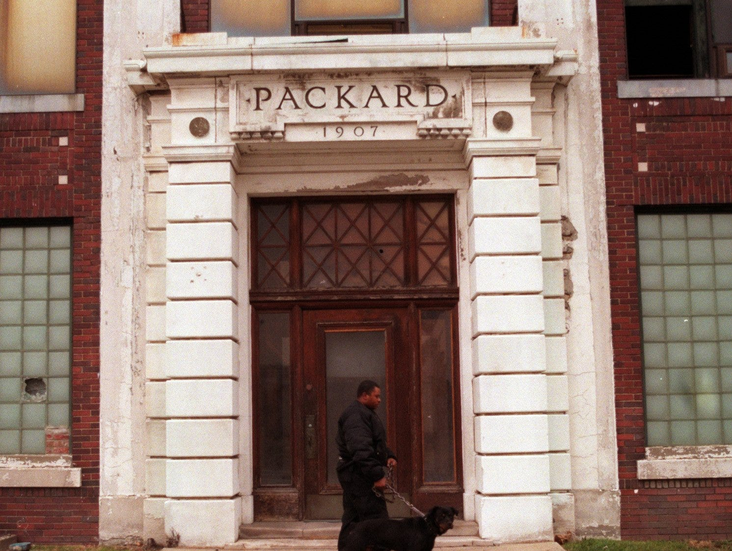 Timothy Chapman and his guard dog Kilo patrol the Packard plant on East Grand Blvd. on November, 20, 1998.