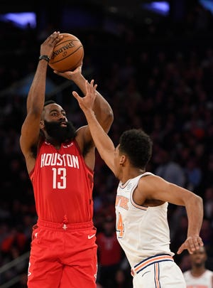 James Harden (13) of the Houston Rockets attempts a basket against Allonzo Trier (14) of the New York Knicks during the second quarter Wednesday. Harden finished with a career-high 61 points in a 114-110 Rockets' victory over the Knicks.