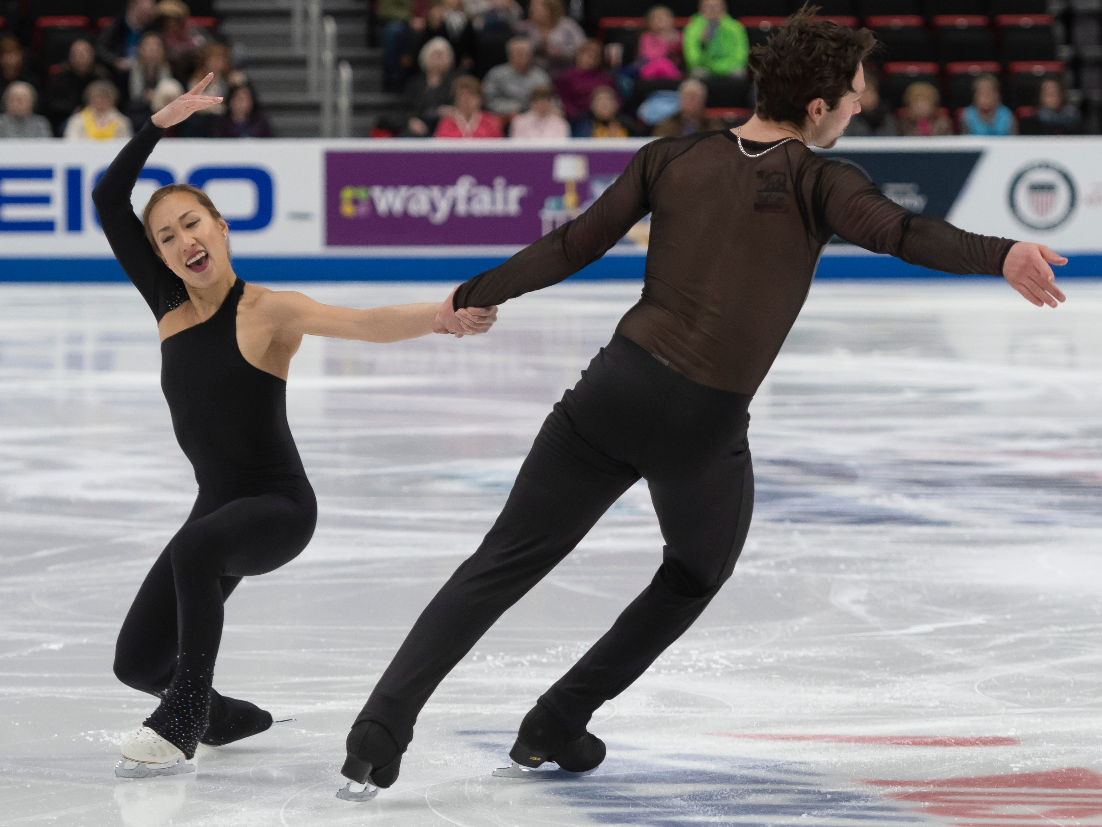 Erika Smith and A.J. Reiss compete in the senior pairs short program at the U.S. Figure Skating Championships.