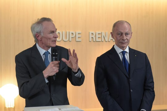 French carmaker Renault's newly appointed board chairman Jean-Dominique Senard, left, delivers a speech next to new chief executive Thierry Bollore during a press conference at the automaker's headquarters in Boulogne Billancourt, near Paris on January 24, 2019.