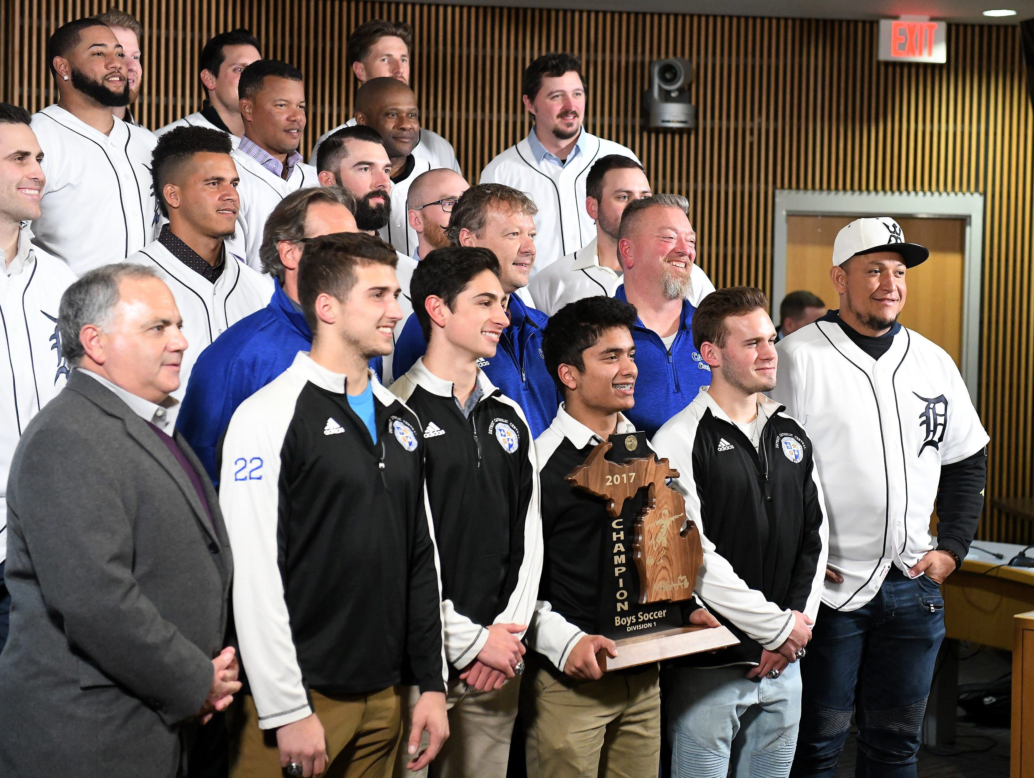 Tigers' Miguel Cabrera, right, and members of the Detroit Tigers take a group photos with some of the Div. 1 champion Novi soccer players during a stop on the 2019 Detroit Tigers Winter Caravan at the Novi Civic Center in Novi, Mich. on Jan. 24, 2019.