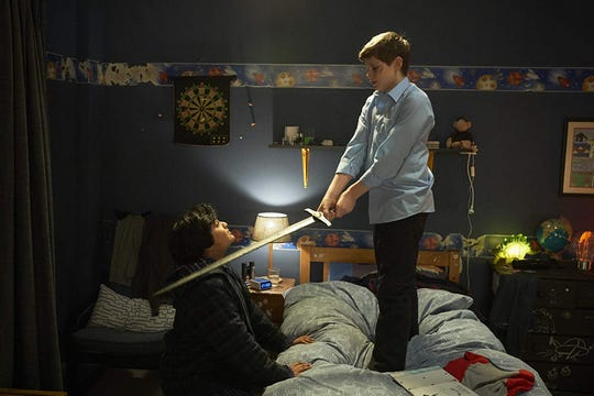 """Dean Chaumoo and Louis Ashbourne Serkis in """"The Kid Who Would Be King."""""""