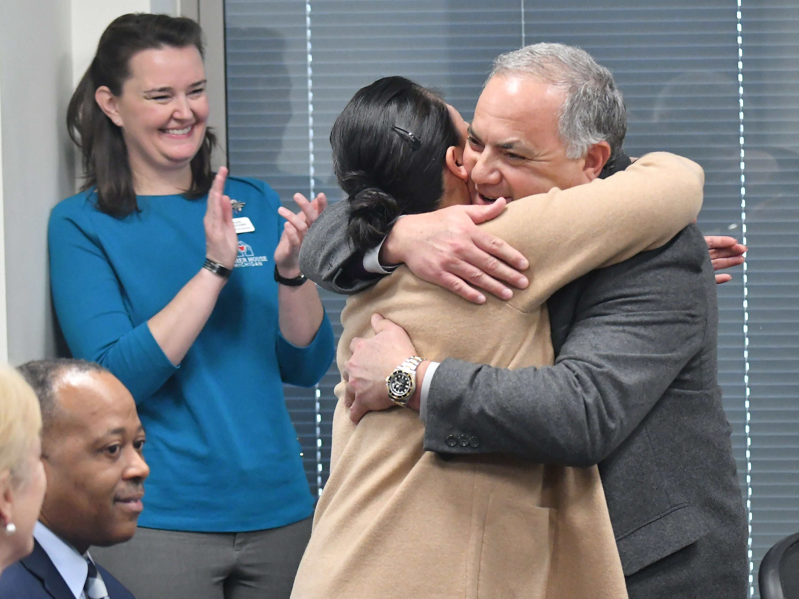 Tigers executive vice president of baseball operations and general manager Al Avila hugs Dorothy Narvaez-Woods whose husband was killed in the line of duty serving as a Navy Seal during a stop on the 2019 Detroit Tigers Winter Caravan at the John D. Dingell VA Medical Center in Detroit on Jan. 24, 2019. Narvaez-Woods spoke at the event and also served in the Navy.