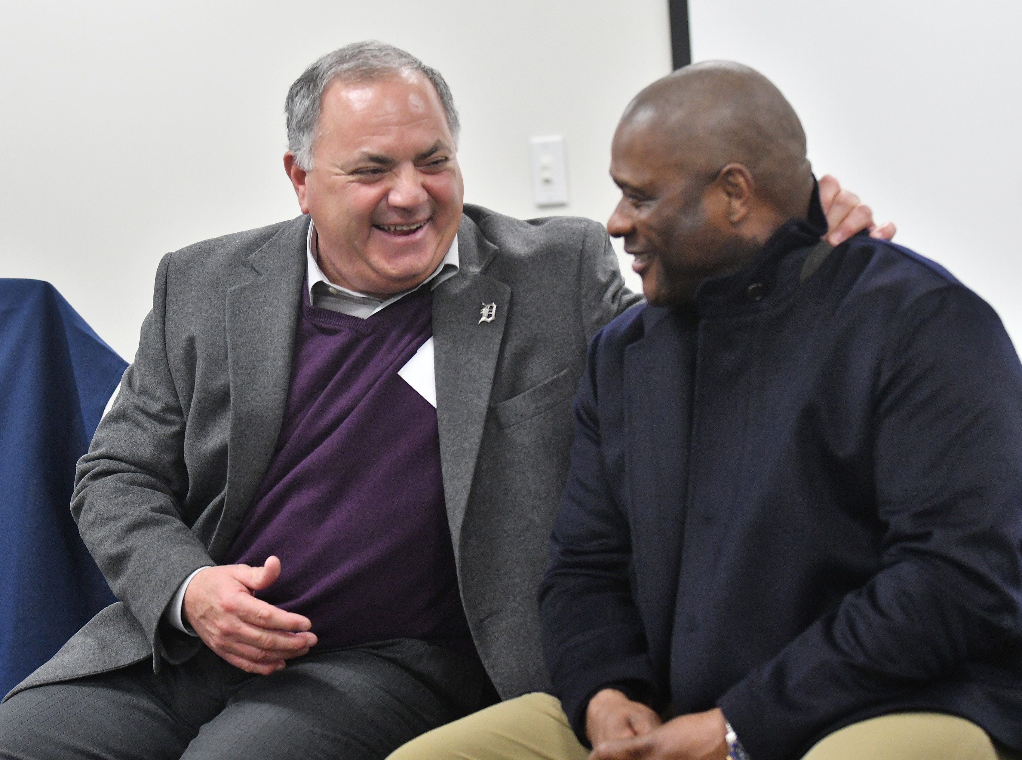 Tigers executive vice president of baseball operations and general manager Al Avila talks with hitting coach Lloyd McClendon, right, during a stop on the 2019 Detroit Tigers Winter Caravan at the John D. Dingell VA Medical Center in Detroit on Jan. 24, 2019.