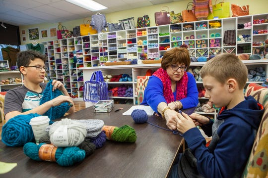 Knitting instructor Rosemarie Russell teaches knitting to Gavin Perry, left, 11, and Michael Goloweyco, 10, both of Grosse Pointe Woods during a class at The Knotted Needle in Grosse Pointe Woods on Saturday, January 19, 2019.