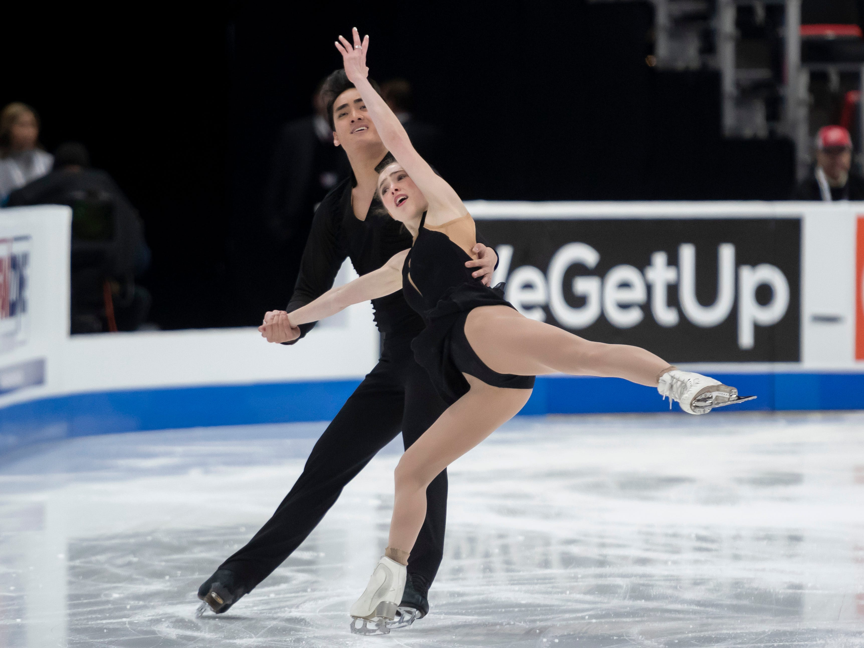 Winter Deardorff and Max Settlage compete in the senior pairs short program at the U.S. Figure Skating Championships.