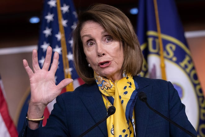 Speaker of the House Nancy Pelosi, D-Calif., talks to reporters a day after officially postponing President Donald Trump's State of the Union address until the government is fully reopened, at the Capitol in Washington, Thursday, Jan. 24, 2019.