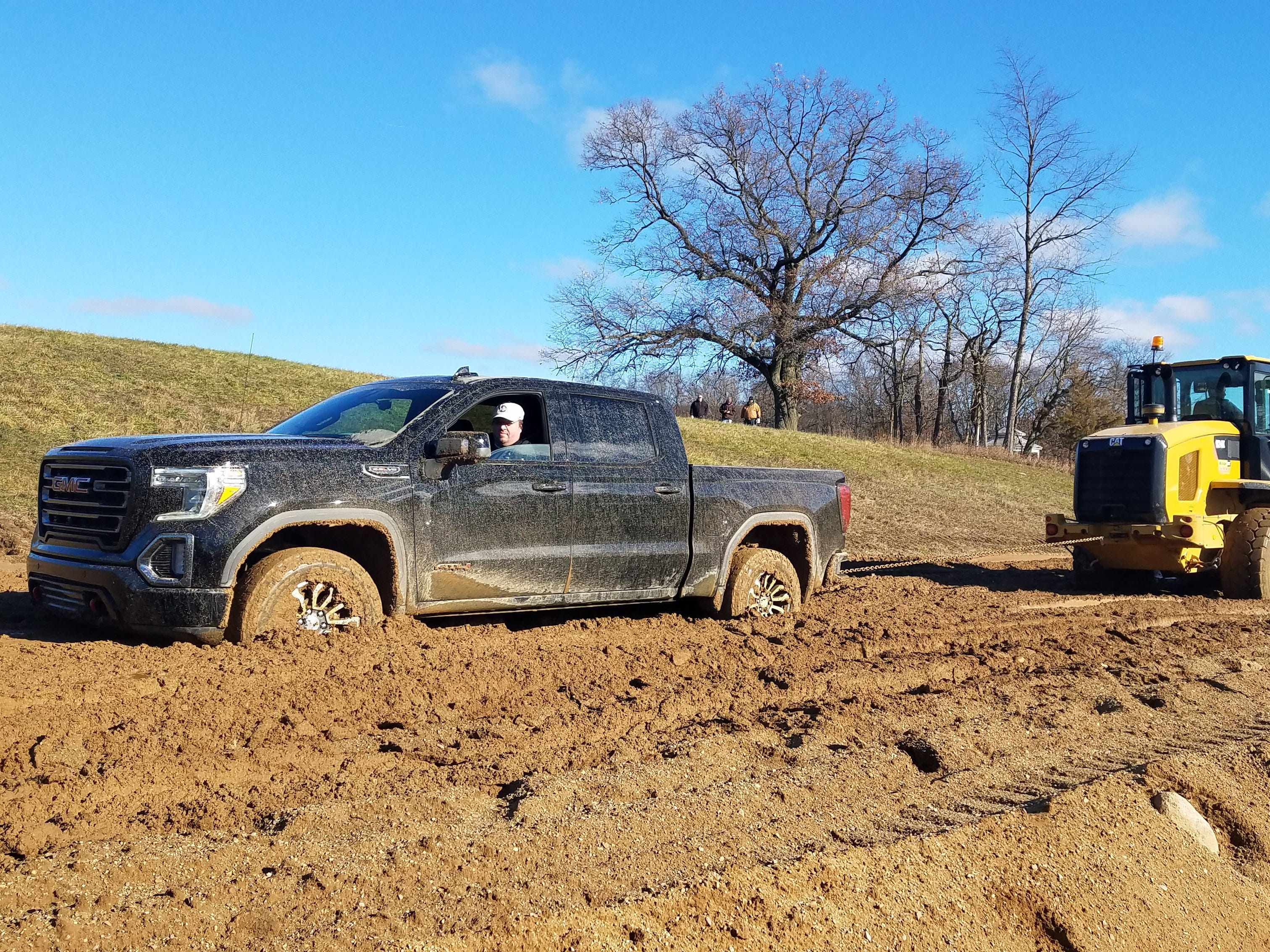 Even the GMC Sierra AT4 can get stuck in sand and mud. Be sure there's a handy Cat backhoe around to pull you out.