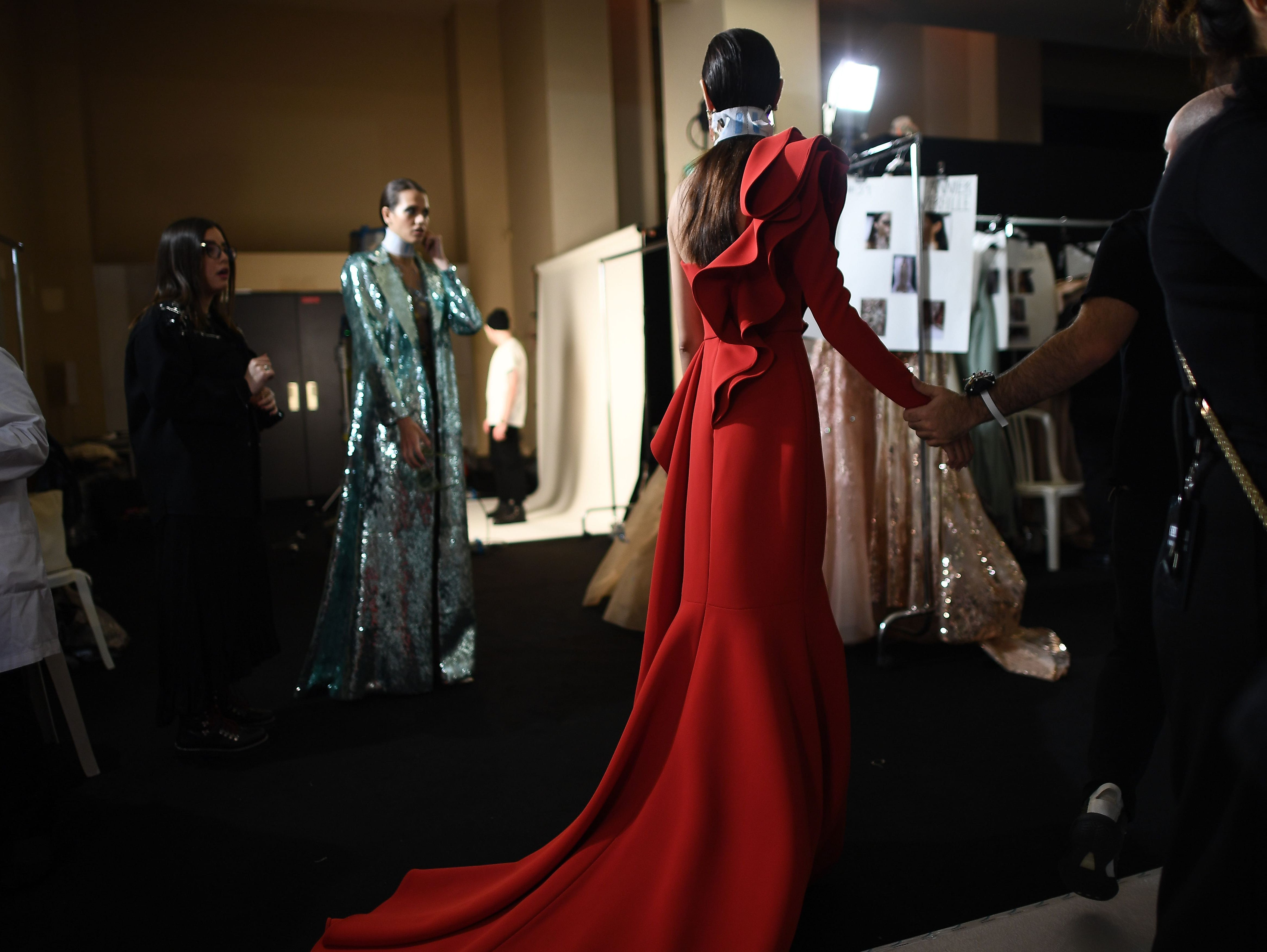 Models get ready prior to the Elie Saab 2019 Spring-Summer Haute Couture collection fashion show in Paris, on January 23, 2019.