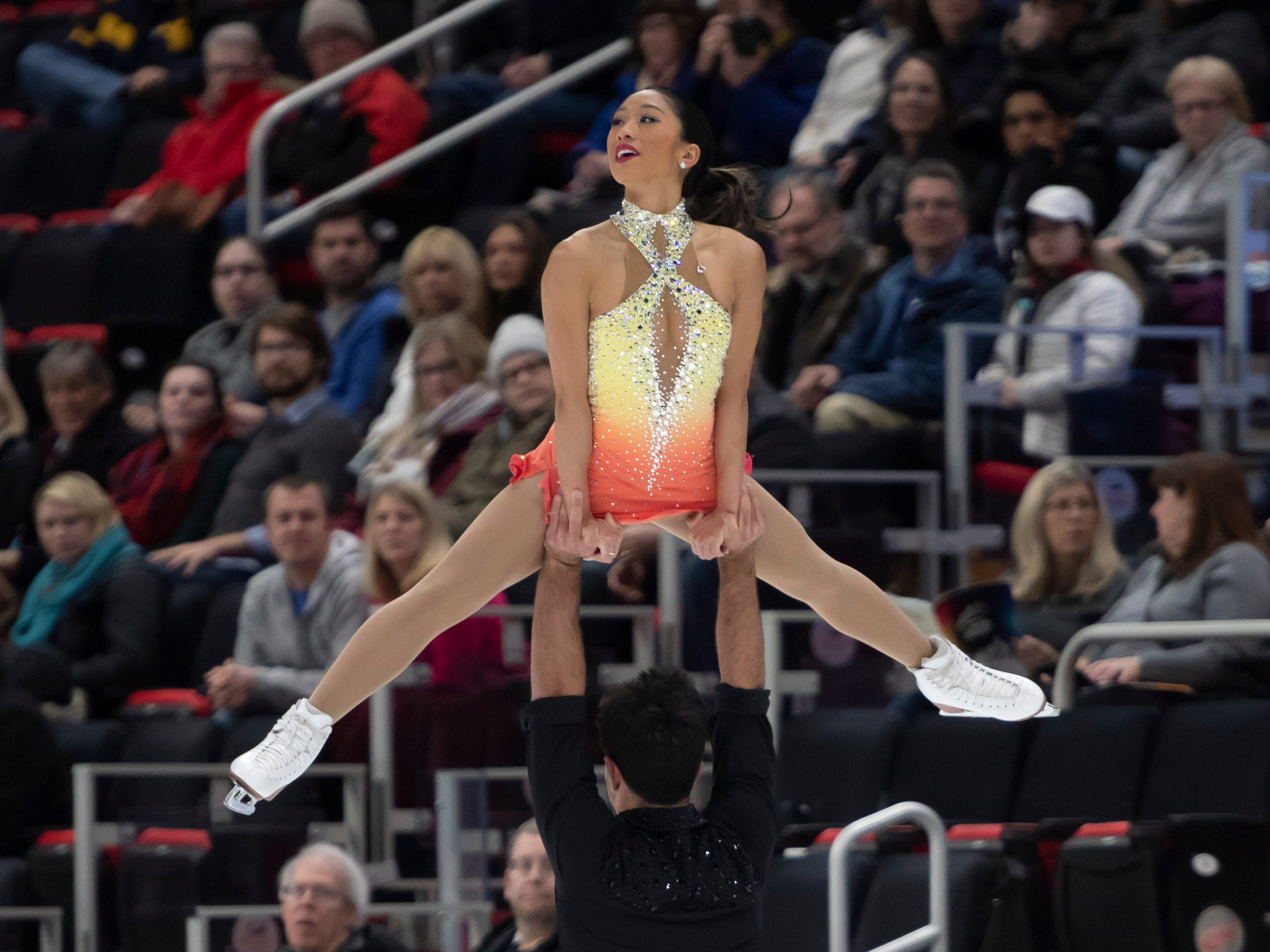 Jessica Calalang and Brian Johnson compete in the senior pairs short program at the U.S. Figure Skating Championships.