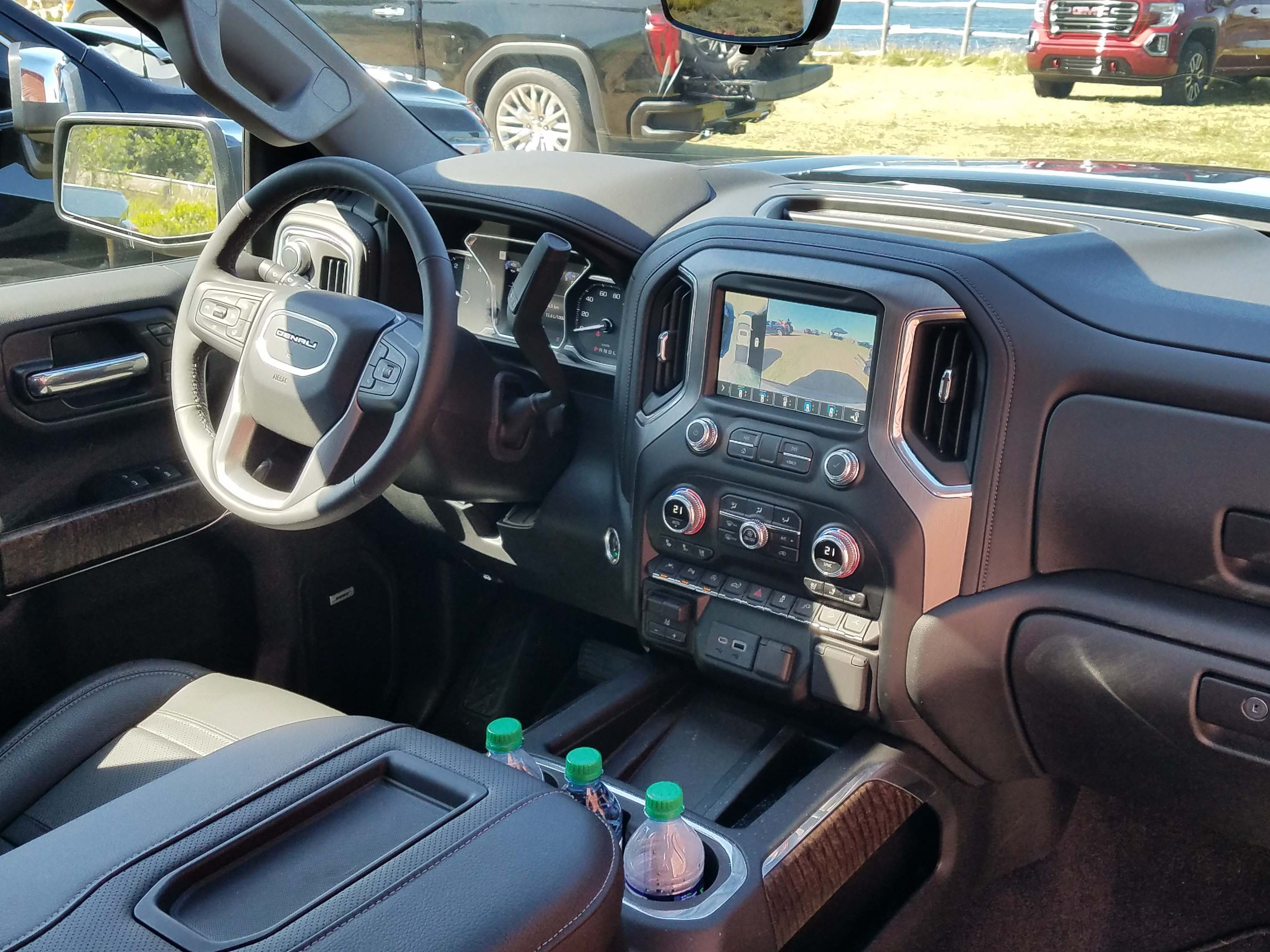 The interior of the 2019 GMC Sierra Denali is not as posh as the upscale Ram 1500 — but its wood-trimmed and leather trimmings are plenty nice, and ergonomics are excellent.