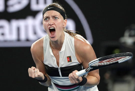 Petra Kvitova of the Czech Republic celebrates after winning the first set against United States' Danielle Collins during their semifinal at the Australian Open Thursday.