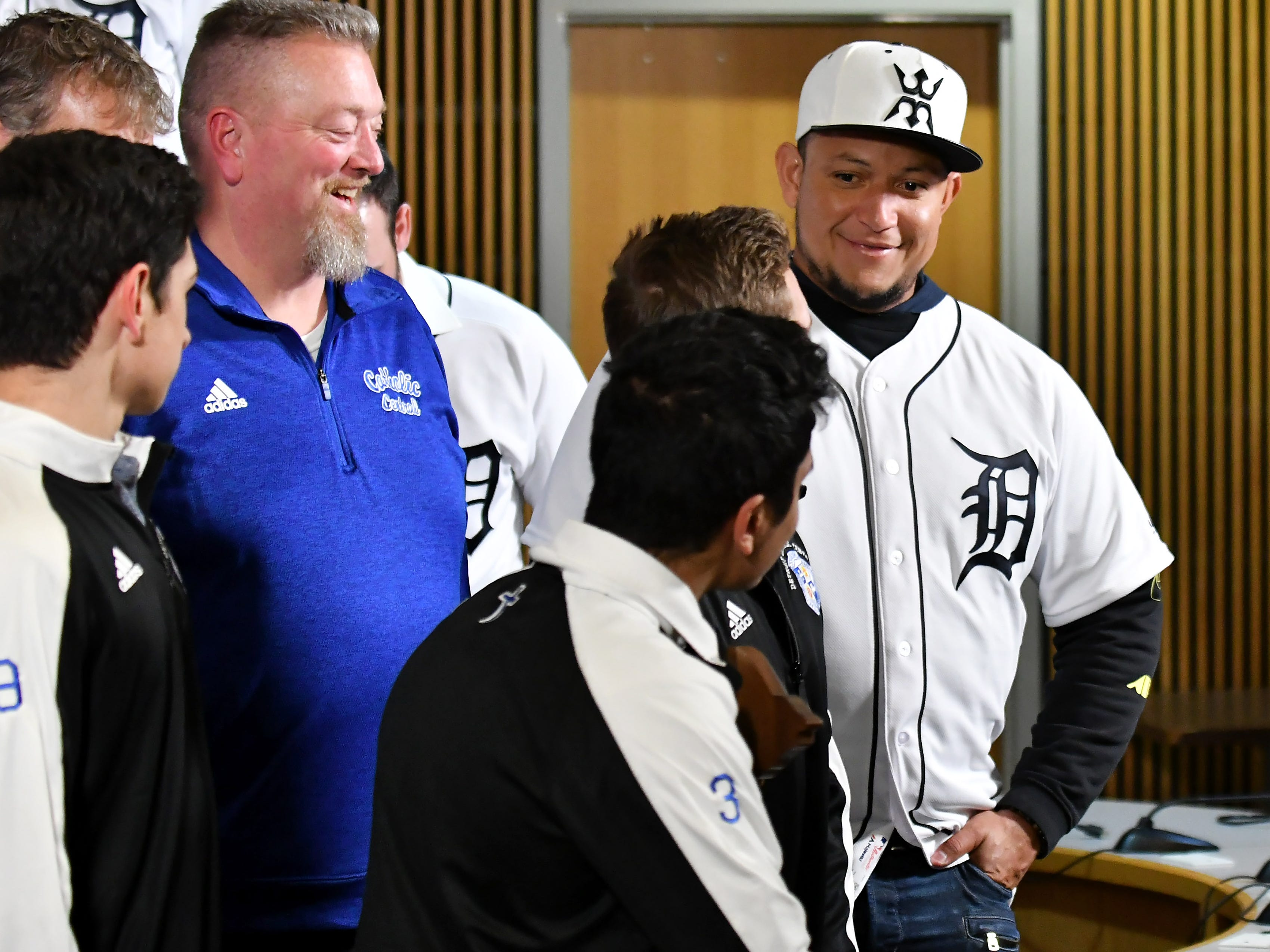 Tigers' Miguel Cabrera jokes around with one of the members of the Div. 1 champion Novi soccer players, Ryan Pierson, after they take a group photo during a stop on the 2019 Detroit Tigers Winter Caravan at the Novi Civic Center in Novi, Mich. on Jan. 24, 2019.