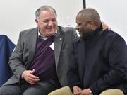 Al Avila, the Tigers executive vice president of baseball operations and general manager, talks with hitting coach Lloyd McClendon during a stop Thursday on the team's winter caravan at the John D. Dingell VA Medical Center in Detroit.