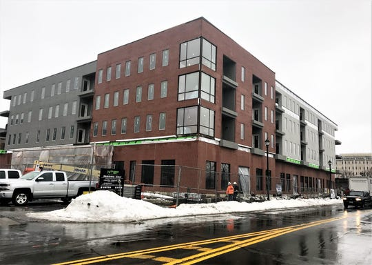 A new mixed-use building on West Water Street in Elmira is set to open this spring.
