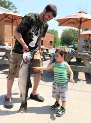 Andrew Gugliotti of Bath captured first place in the 2018 National Lake Trout Derby on Seneca Lake with a nearly 13-pound laker.