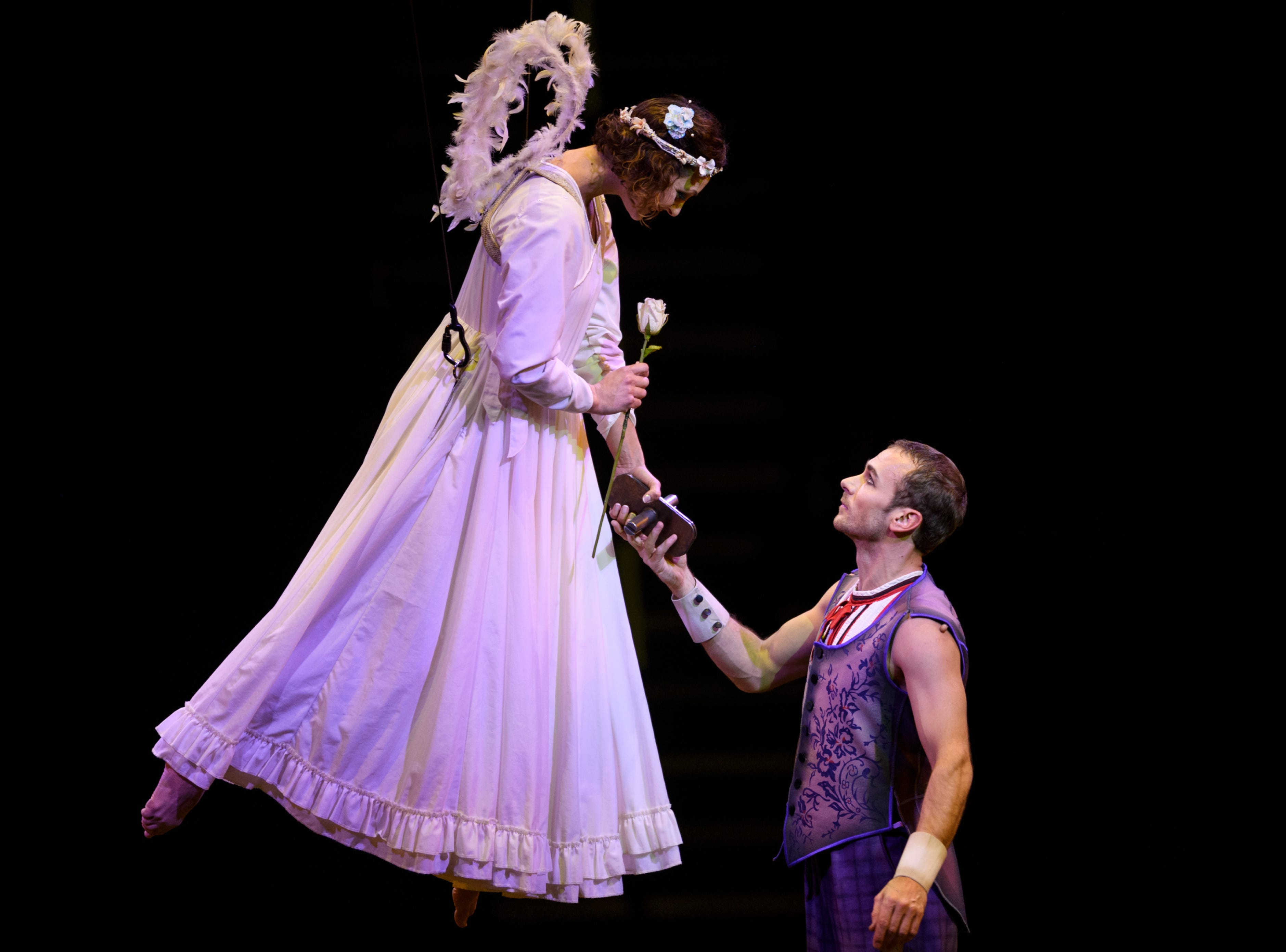 "Cirque du Soleil Corteo performers meet on stage during in the show's ""Acrobatic Ladder"" act at Ford Center in Evansville, Ind., Wednesday night, Jan. 23, 2019."
