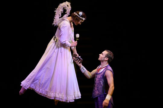 """Cirque du Soleil Corteo performers meet on stage during in the show's """"Acrobatic Ladder"""" act."""