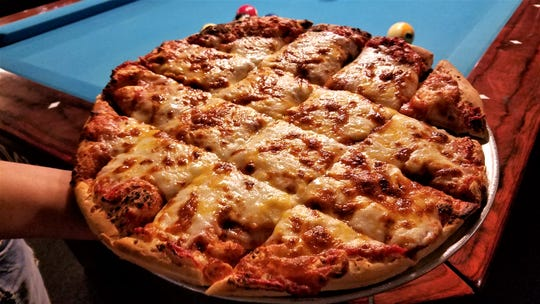 The pizza at Mojo's BoneYard is baked on homemade crust with homemade sauce. Pictured is the super cheesy specialty Government Cheese.
