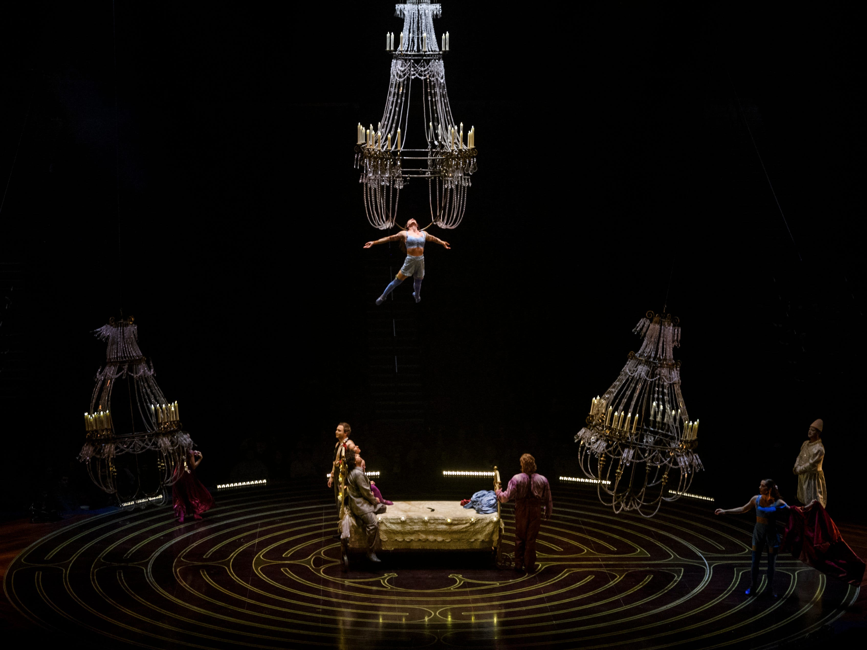Erin Cervantes, top center, suspends from a giant chandelier above the stage during Cirque du Soleil's Corteo at Ford Center in Evansville, Ind., Wednesday night, Jan. 23, 2019. She plays one of four women who were Mauro the Dreamer Clown's former loves.