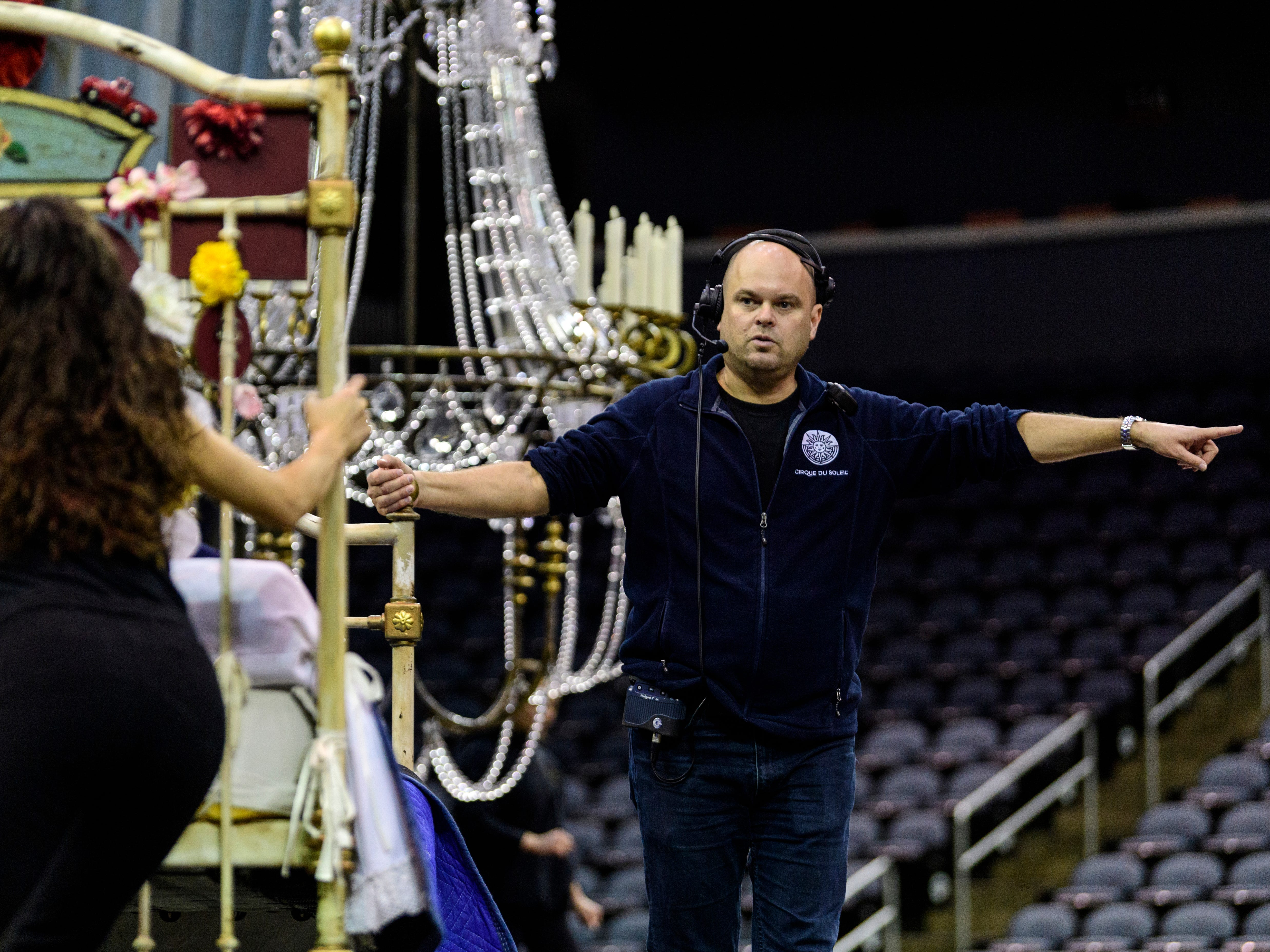 General Stage Manager Grant Gravener, right, helps direct cast members on stage during Cirque du Soleil's Corteo rehearsal at Ford Center in Evansville, Ind., Wednesday, Jan. 23, 2019.