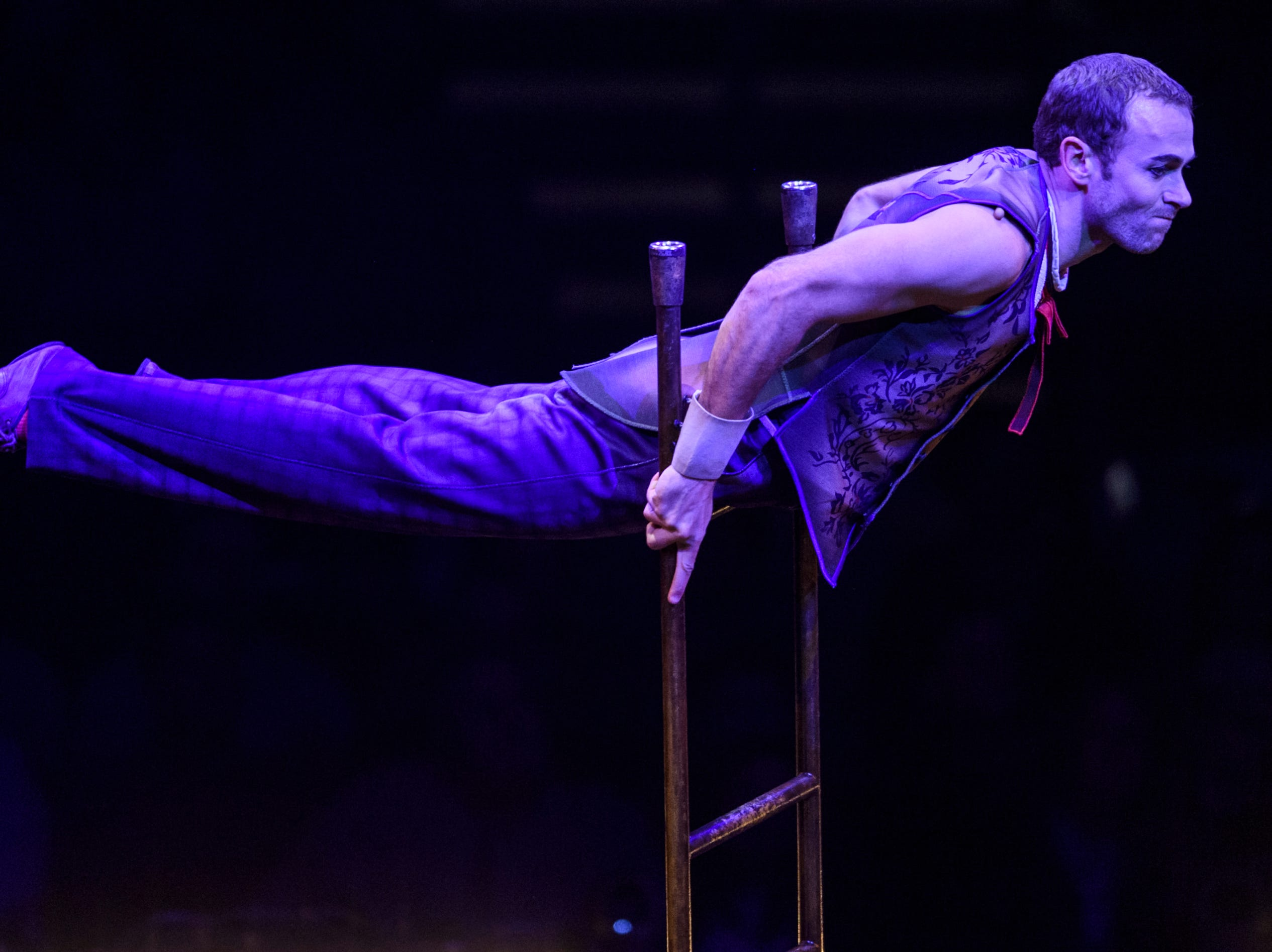 "A performer balances during the ""Acrobatic Ladder"" act of Cirque du Soleil's Corteo at Ford Center in Evansville, Ind., Wednesday night, Jan. 23, 2019."