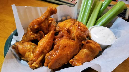 Wednesday and Sunday are special wing days at Mojo's BoneYard, but the crisp fried wings and house-made sauces are great every day.