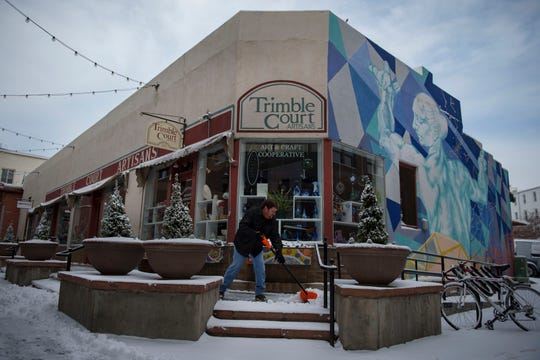 Dan Forde shovels snow in front of Timble Court Artisans on Thursday, Jan. 24, 2019, in Old Town Fort Collins, Colo.