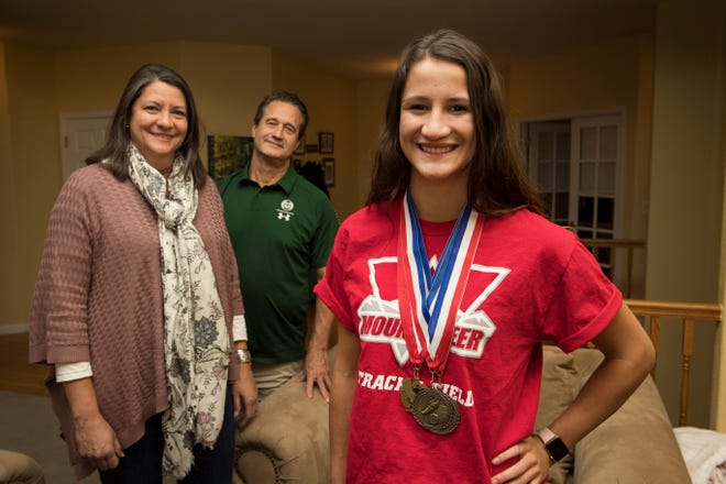 Volleyball and track athlete Myles Hilbert is pictured with her mother, Leslie Taylor, and father, Colorado State University head volleyball coach Tom Hilbert, at their home on Tuesday, Jan. 23, 2019, in Fort Collins, Colo.