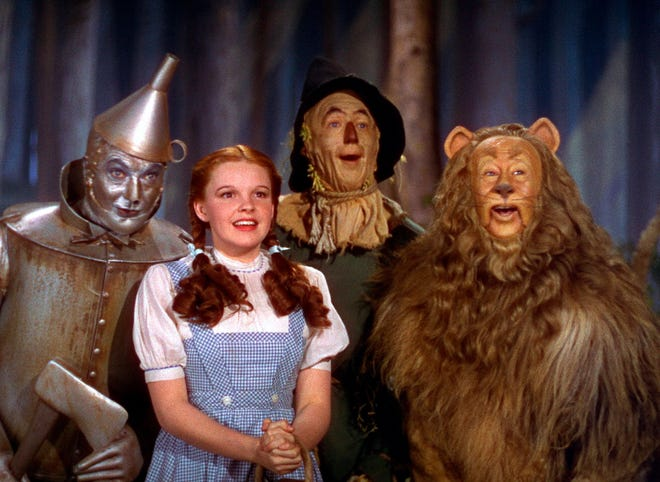 """Jack Haley, left, Judy Garland, Ray Bolger and Bert Lahr in the 1939 movie """"The Wizard of Oz."""" For its 80th anniversary, theaters across the country are bringing the classic back to the big screen."""